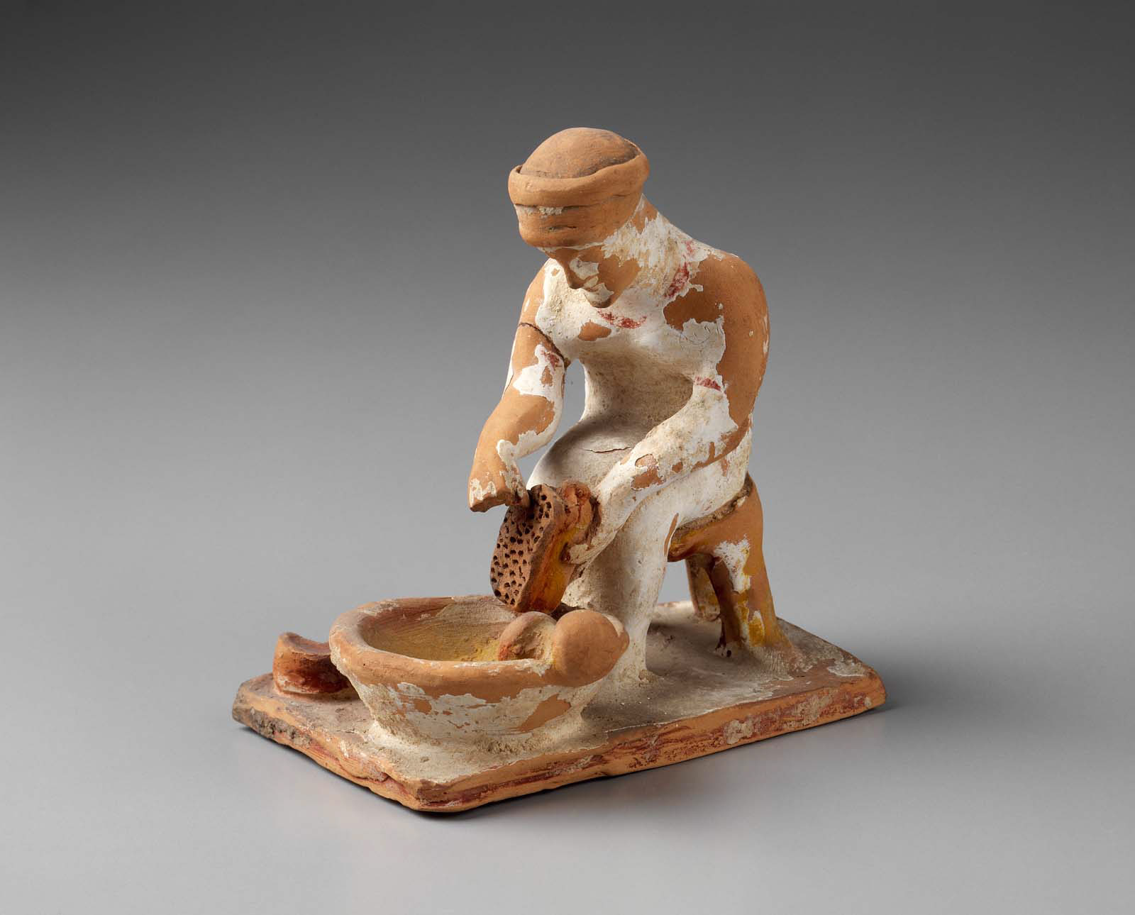 Woman grating cheese - Greek -Late Archaic Period -Early 5th century B.C.